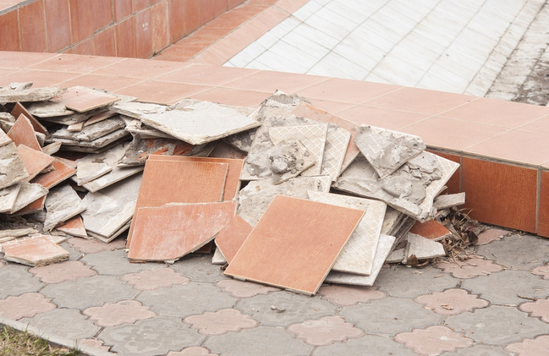 A pile of broken tiles removed from tile flooring demolition