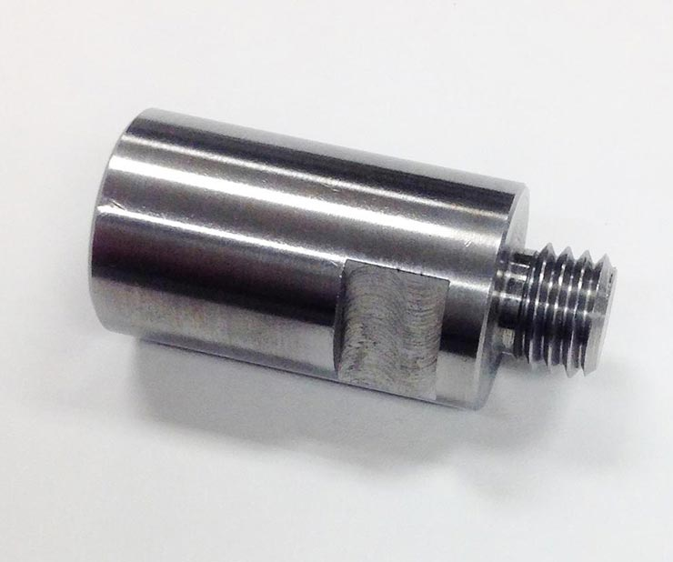 a tool that attaches to the grinding wheel of a grinder